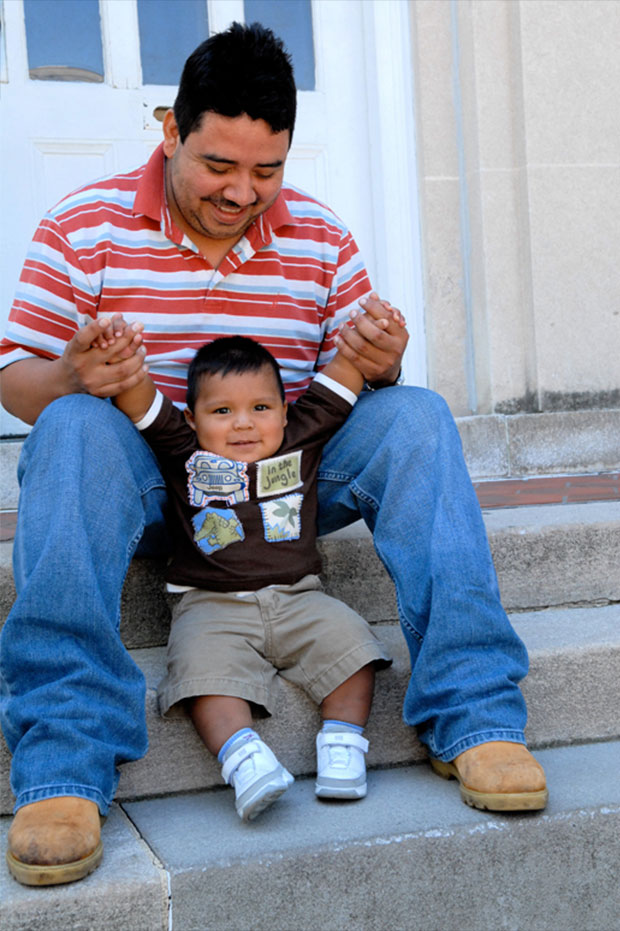 Dad and baby on steps