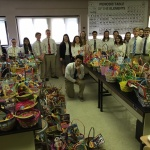 Dearborn Divine Child High School students made Easter baskets for kids at All Saints in 2016